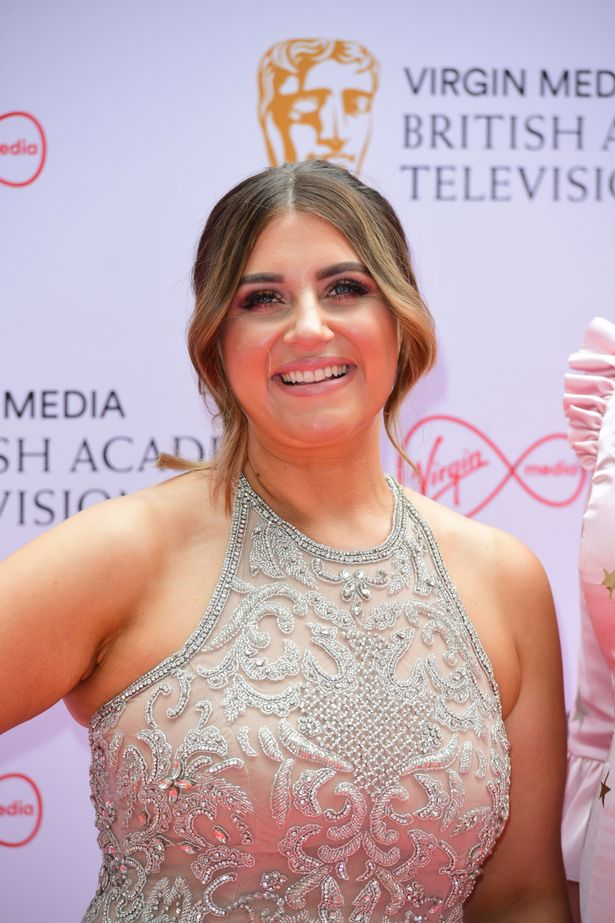 Izzi Warner looked gorgeous in a figure hugging nude dress with metalic lace detailing