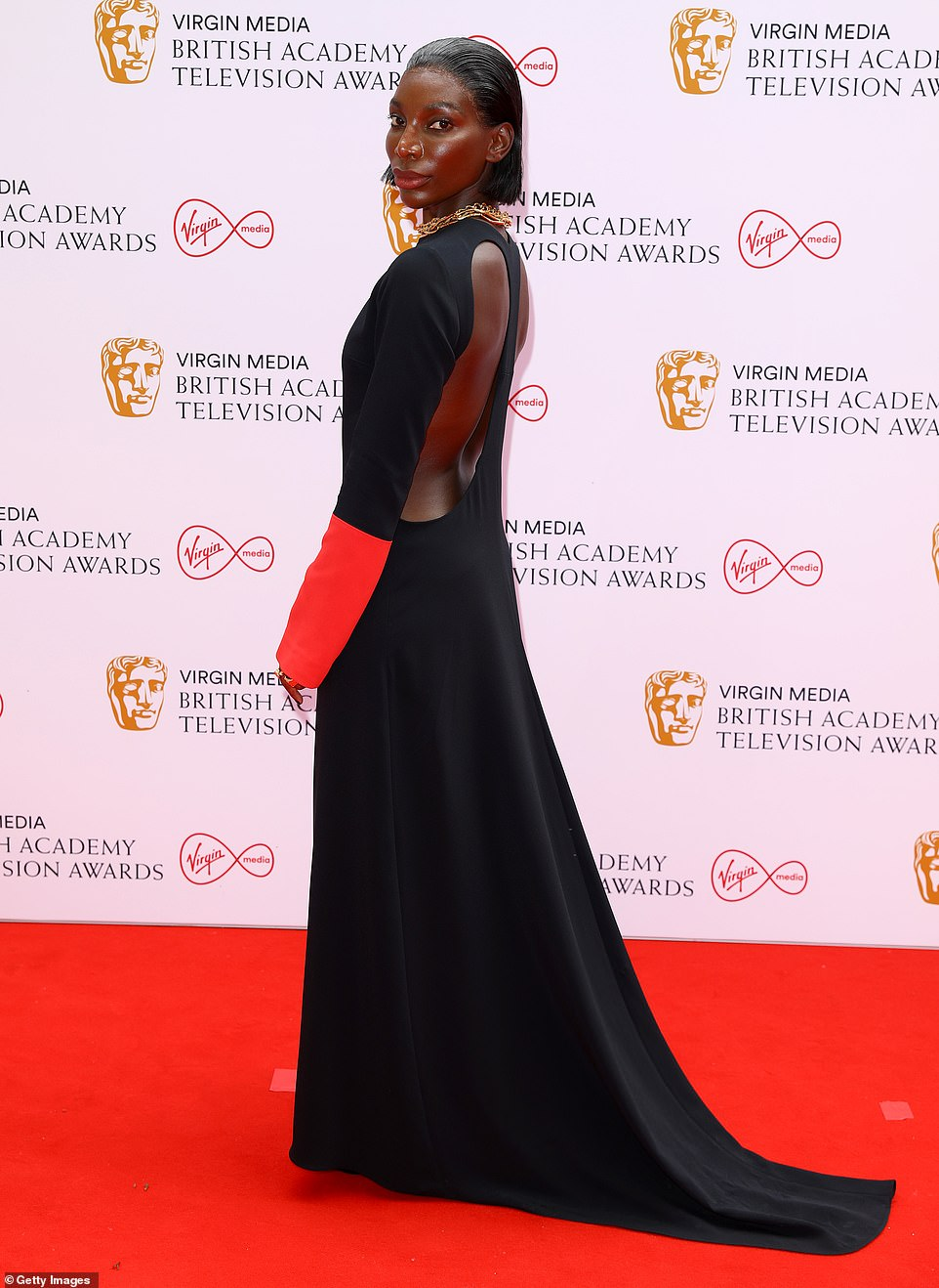 Eye-catching: Michaela Coel looked sensational as she made her way down the red carpet in a flowing black backless gown