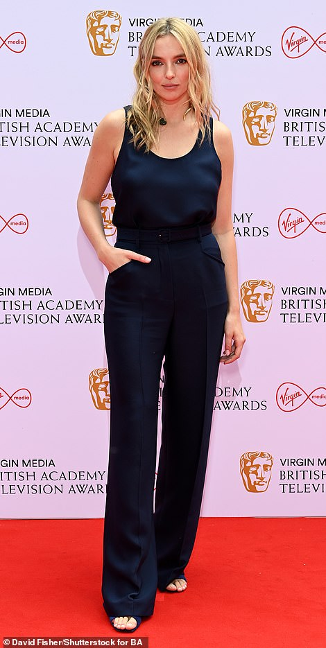 Elegant: Fellow nominee Jodie kept things simple yet elegant in a navy sleeveless top with matching high-waisted trousers
