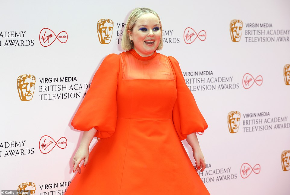 Captivating red carpet look: The Derry Girls star's gown featured a sheer chiffon overlay at the neckline and puffy mid-sleeves