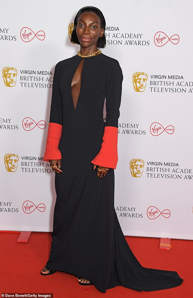 Stunning: The TV staradded a selection of gold accessories to her gown, including a chunky chain necklace and some statement rings