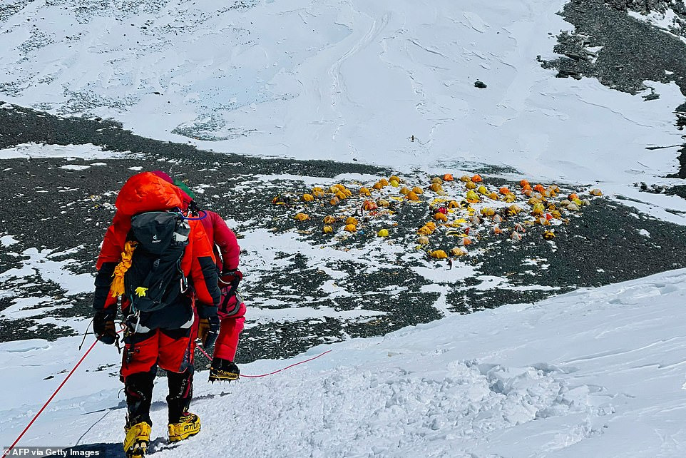 Mountaineers look back towards Camp 4, the final camp along the trek, before making their way up to the summit of Everest
