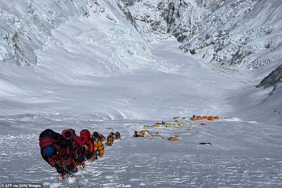 A group of mountaineers make their way up to the summit of Mount Everest, 29,000ft above sea level