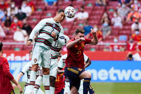 Cristiano Ronaldo headers the ball