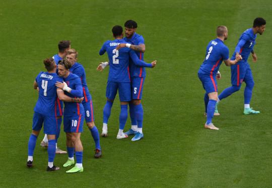 England players hug one another