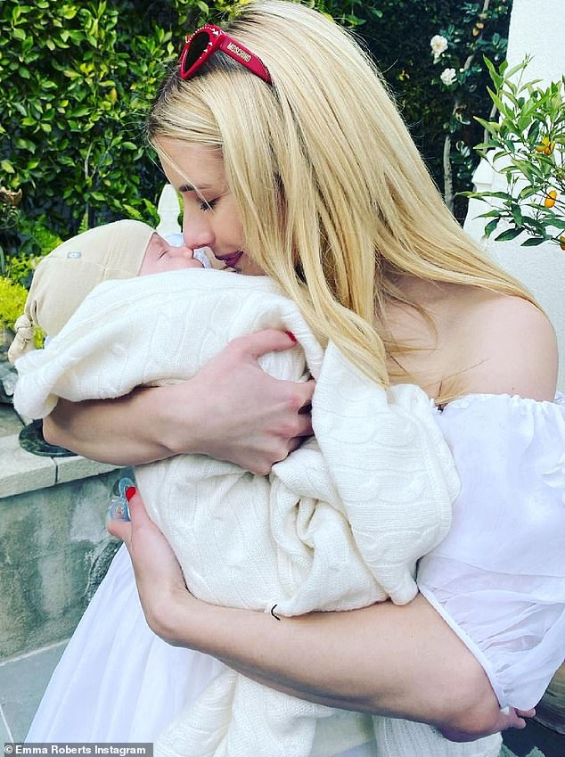 Baby mine:Emma welcomed her baby boy Rhodes on December 27 and shares him with her beau Garrett Hedlund whom she has been with since 2019 (pictured in May)