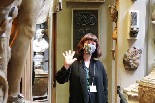 Katie Weston waving in the Sir John Soane's Museum