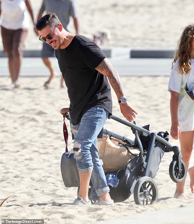 He's got this: Jax took on the tricky task of getting the stroller across the sand