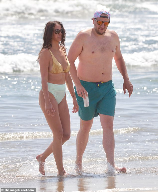 The former Bravo star was seen with boyfriend Alex Menache who went shirtless in some turquoise swim shorts
