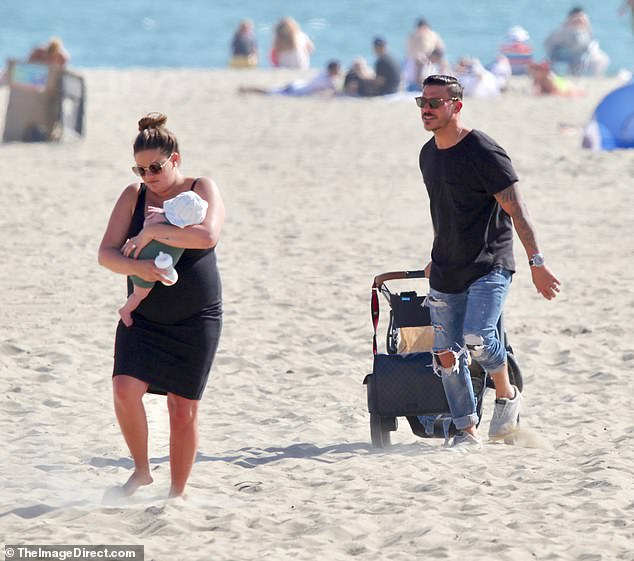 Well prepared: The couple came to the beach with a stroller and diaper bag