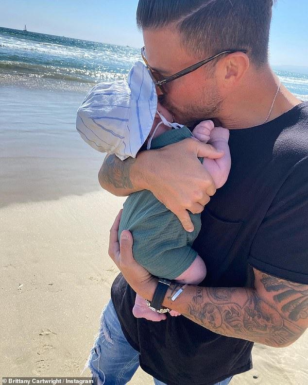 Beach days: One snap showed Jax giving his little boy a big kiss