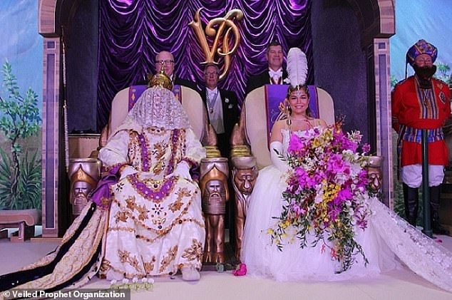 The ceremony: Theannual Veiled Prophet Ball is still held each year where the winner is crowned by a 'Veiled Prophet' (pictured on left) - a member of the organization who covers their face with a white veil so their identity remains secret