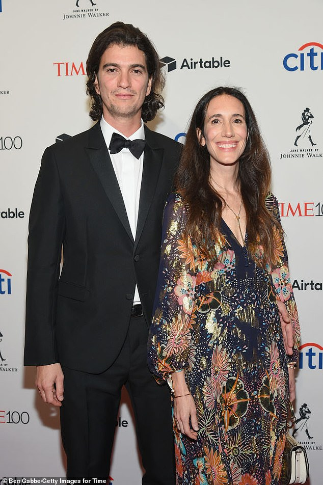 The real thing: Following revelations about erratic management and business practices, the Neumanns (pictured in 2018) resigned in 2019 from WeWork, which reported a $2.1B loss in May despite having 490K members