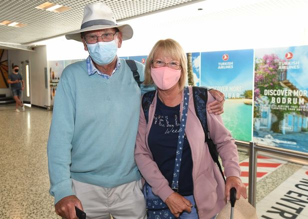 Andrew and Lyn Ball pose for a photo after landing at Birmingham Airport on a flight from Madeira