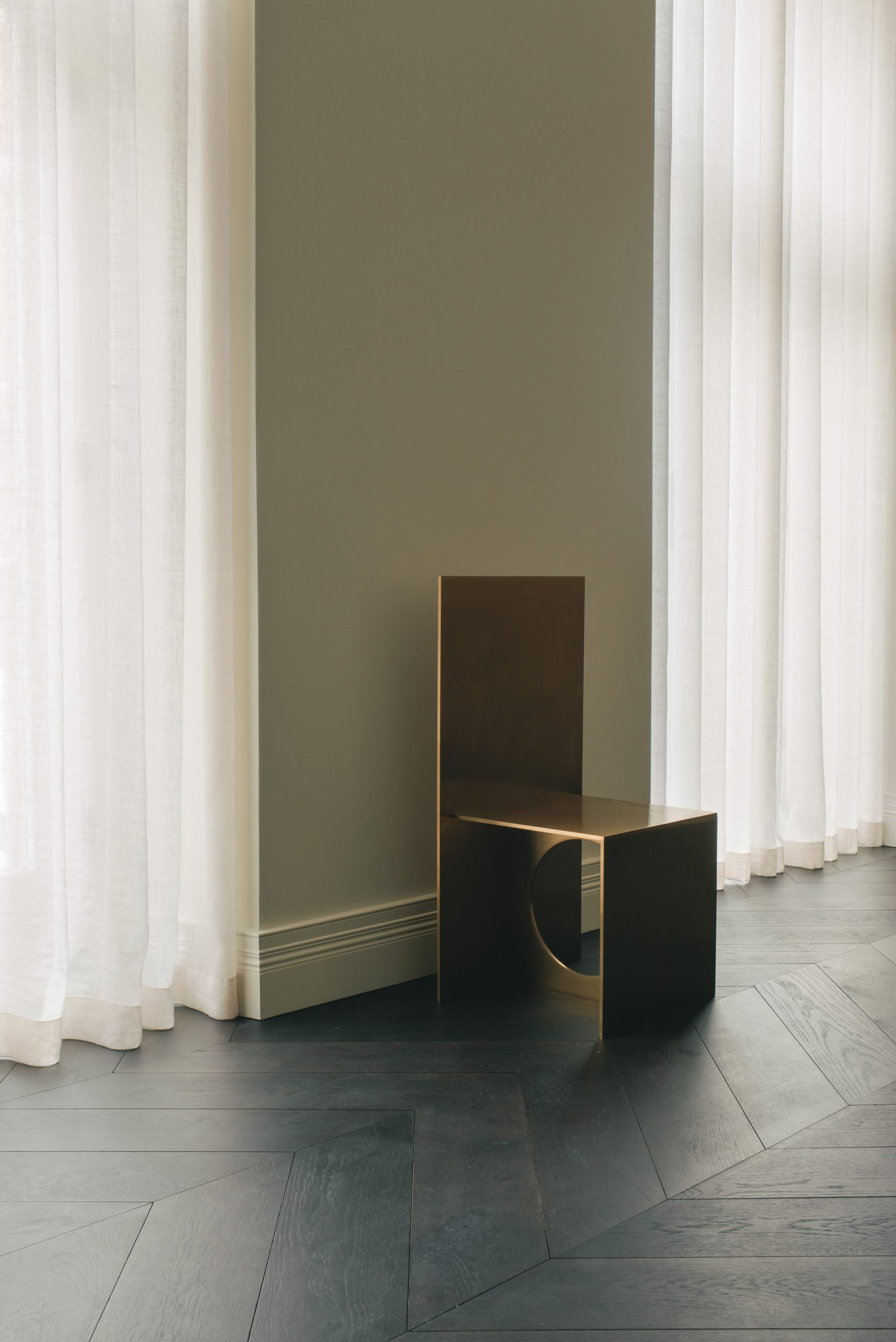 Gold-coloured chair in London office by Hollie Bowden