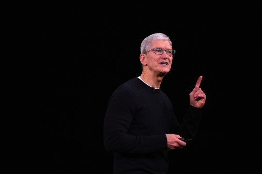 (FILES) In this file photo taken on September 10, 2019 Apple CEO Tim Cook speaks on-stage during a product launch event at Apple's headquarters in Cupertino, California. - Apple chief Tim Cook on Octorber 10, 2019, defended the decision to pull an app used by protesters in Hong Kong to track police, according to a leaked email to employees obtained by a tech news site. Apple removed the HKmap.live mobile application from the App Store after criticism by Beijing, which is stepping up pressure on foreign companies deemed to be providing support to the pro-democracy movement. (Photo by Josh Edelson / AFP) (Photo by JOSH EDELSON/AFP via Getty Images)