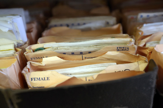 Folders containing patient records are pictured in a GP surgery in London, England. (Getty)