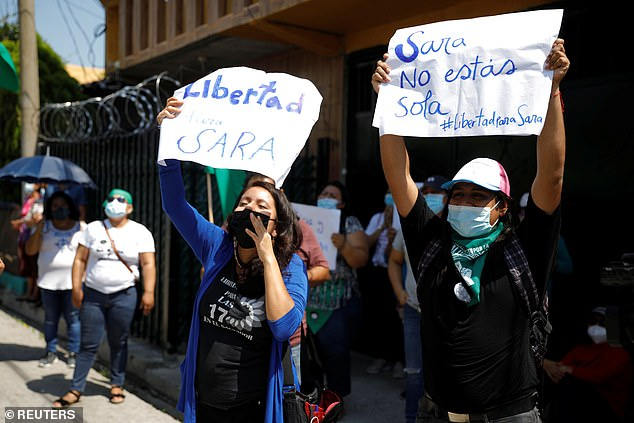 Women hold placards that read, 'Freedom for Sara' and 'Sara you are not alone' during a protest as Sara Rogel attended a hearing inCojutepeque, El Salvador on May 31 where a judge ordered her release