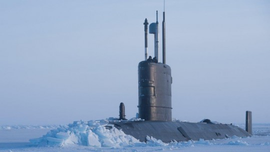 HMS Trenchant breaking through ice (Picture: Crown Copyright).