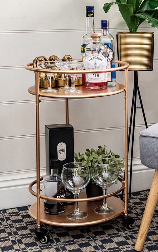 This glamorous drinks trolley in gold is a great update for your interior now we have guests back in our homes. The two-tier shelving is perfect for displaying your favourite tipples, glassware or even plants. It comes on wheels (with brakes!) so you can manoeuvre it from room to room ? or take it out to the garden. Small Round Drinks Trolley, ?59.99