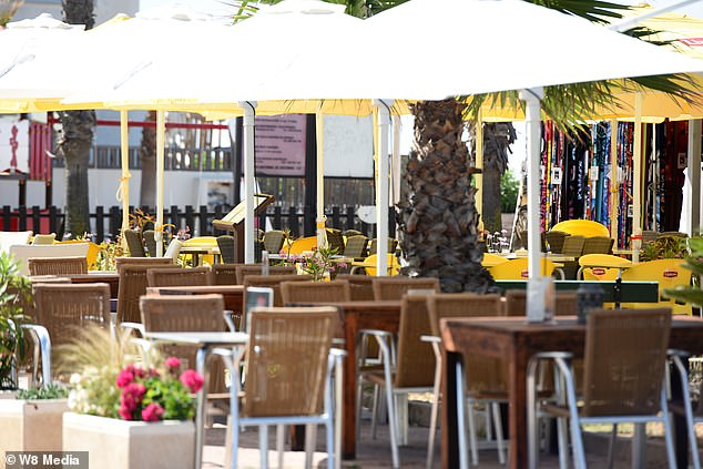 A beachfront bar in the Algarve, one of Portugal's top tourist destinations, sits empty today after British visitors raced home to avoid new quarantine rules