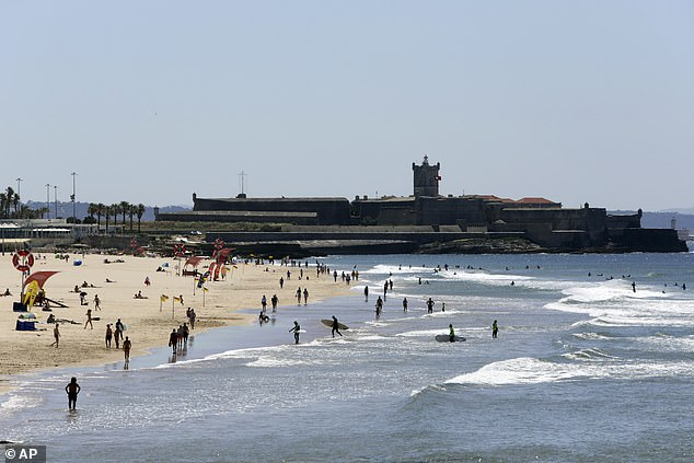 Carcavelos beach, near Lisbon, is seen on June 4 as tourists visit - ahead of a rule-change which forced Britons to flee the country