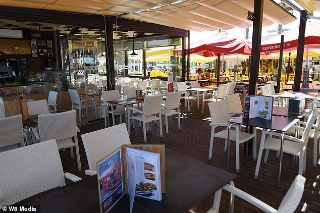 A restaurant near Faro, Portugal, sits near-empty on Tuesday after Britons left the country to avoid new border quarantine rules back home