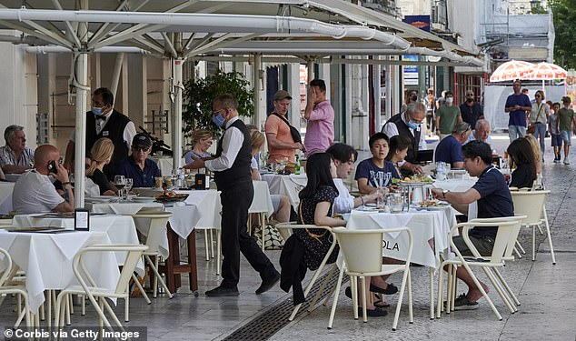 Tourists are seen packed into a restaurant in Lisbon, Portugal, on May 30 before all British sunseekers were told to leave the country