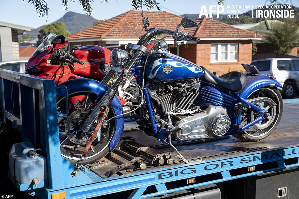Luxury Ducati and Harley Davidson motorcycles are hauled away by police officers after they raided hundreds of suspects last night. A new Ducati costs north of £18,000, while a Harley-Davidson will set you back more than £12,000