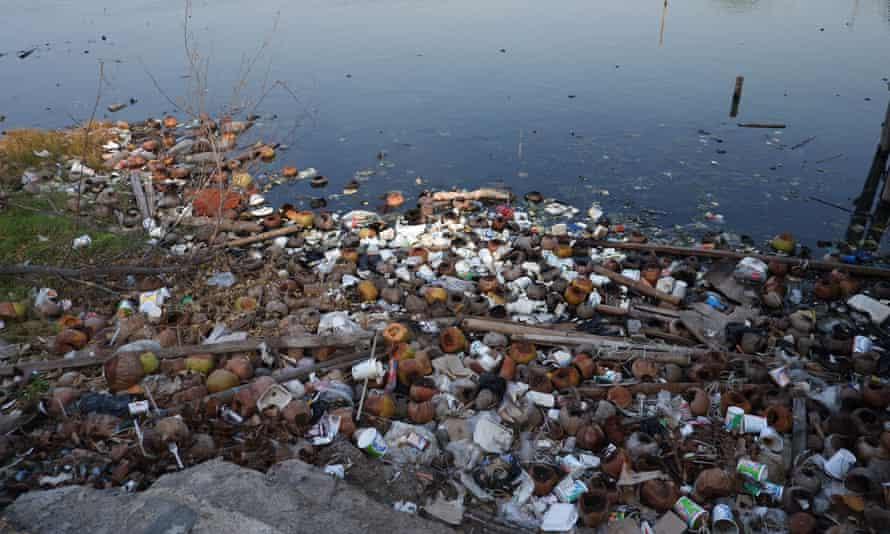 Piles of garbage around Marunda beach.
