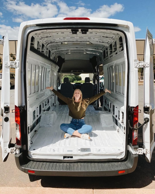 Malory sitting in the van before they converted it