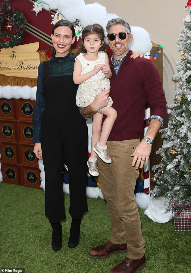 Little one:Odette and Dave welcomed their first and only child, daughter Charlie Mae, five, in 2015; Odette, Charlie, and Dave pictured in 2018