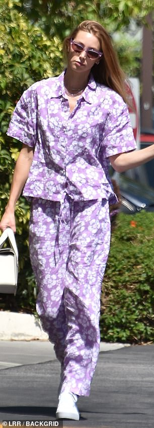 Flower power! Port rocked the amethyst ensemble with confidence as she strutted through the sunshine with her glossy blonde hair slicked back