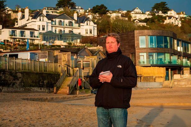 Mirrorman Ben Glaze in front of Carbis Bay