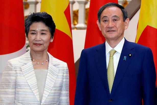 Japan's Prime Minister Yoshihide Suga with his wife Mariko Suga