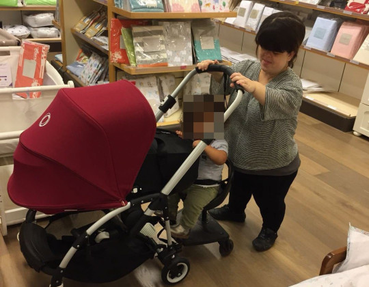 Cathy Reay with her first child and a pram
