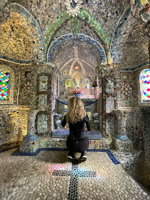 Small stained-glass windows cast a rainbow of colour on the floor which have been fashioned out of smooth pebbles (Photo: Sadie Whitelocks)