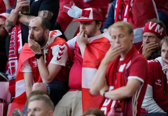 COPENHAGEN, DENMARK - JUNE 12: Denmark fans look dejected as Christian Eriksen (Not pictured) of Denmark receives medical treatment during the UEFA Euro 2020 Championship Group B match between Denmark and Finland on June 12, 2021 in Copenhagen, Denmark.