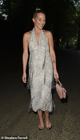 Looking good: She accessorised with a pair of strappy heels and a pink Dior bag