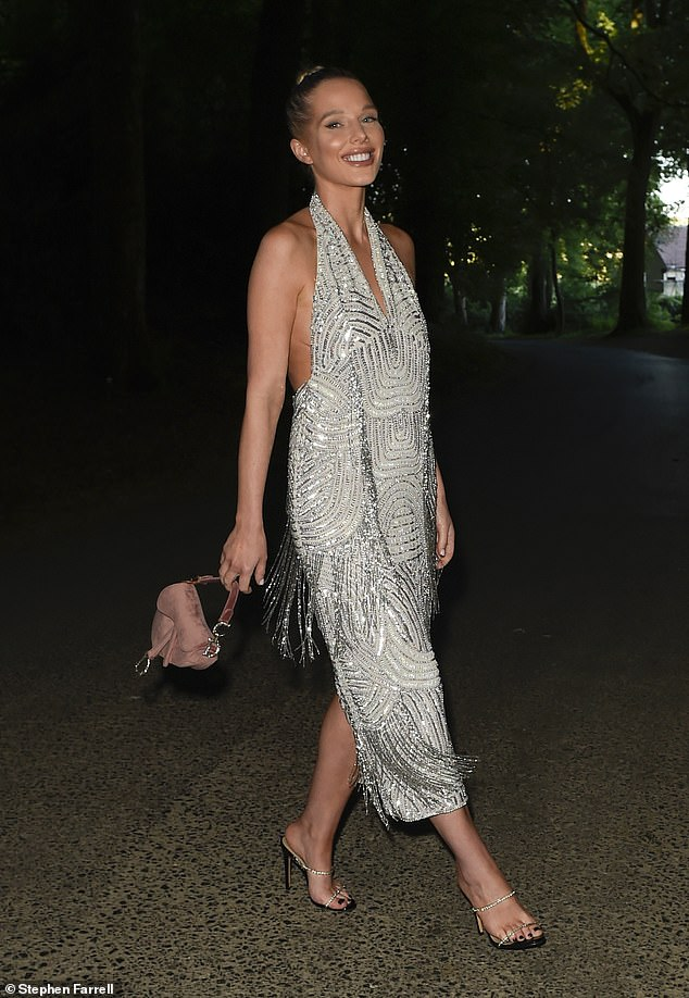 Work it: Helen ensured to work all her angles while posing up a storm in her glitzy dress