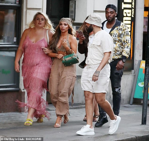 Out and about: The former Little Mix star looked picture perfect as she strolled along the street with her friends in London on Sunday