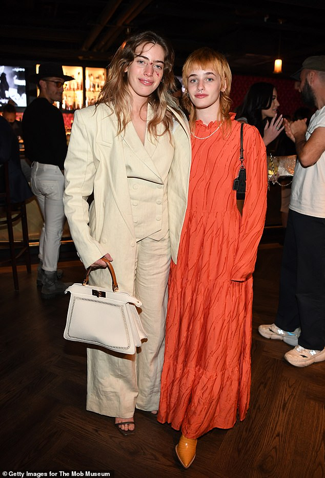 Family affair: Clara posed with her younger sister Esther at the Las Vegas event
