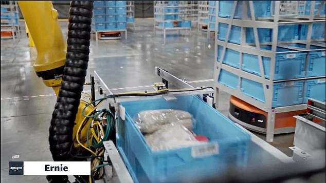 Ernie (pictured) is able to take totes off a shelf, deliver it to employees with its robotic arm, allowing them to remain in a more comfortable position