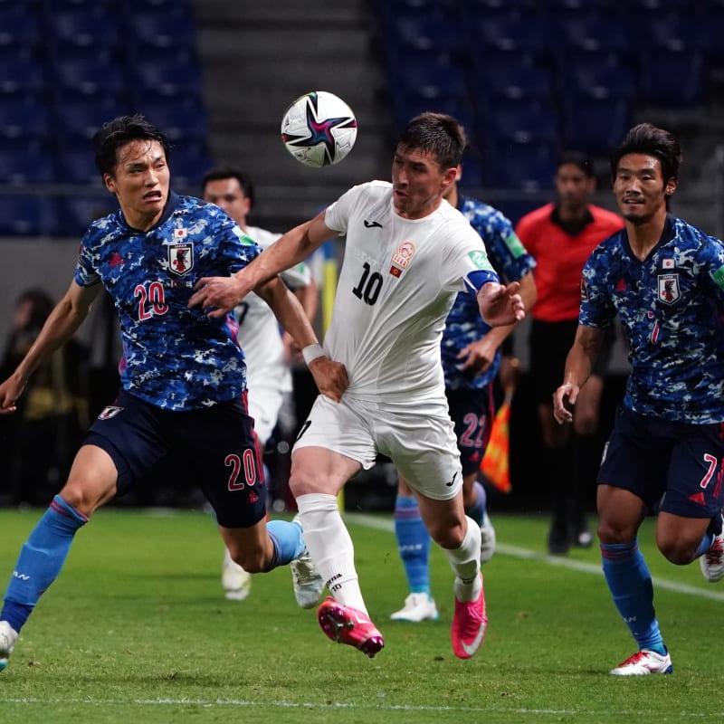 Mirlan Murzaev of Kyrgyz Republic and Shinnosuke Nakatani of Japan compete for the ball