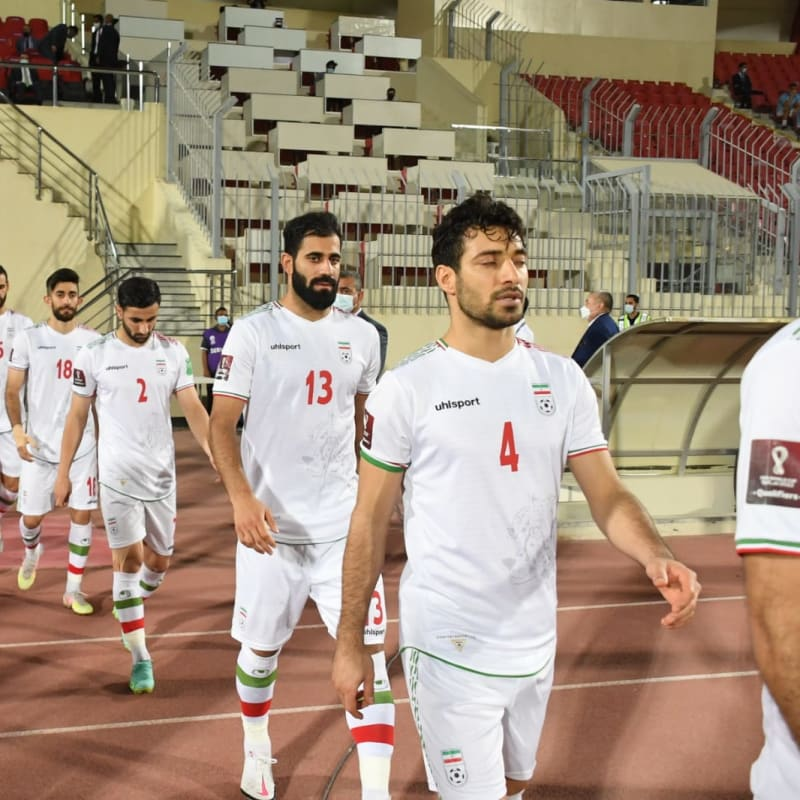 IR Iran walk out onto the pitch ahead of the match against Iraq