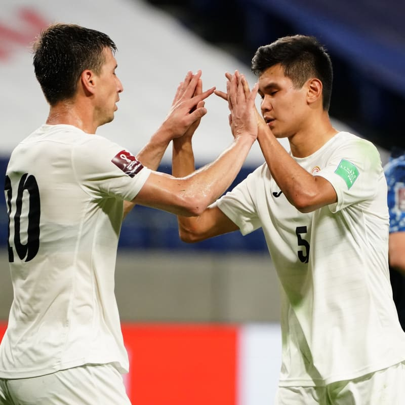 Mirlan Murzaev (L) of Kyrgyz Republic reacts after scoring his side's first goal with his team mate Aizar Akmatov