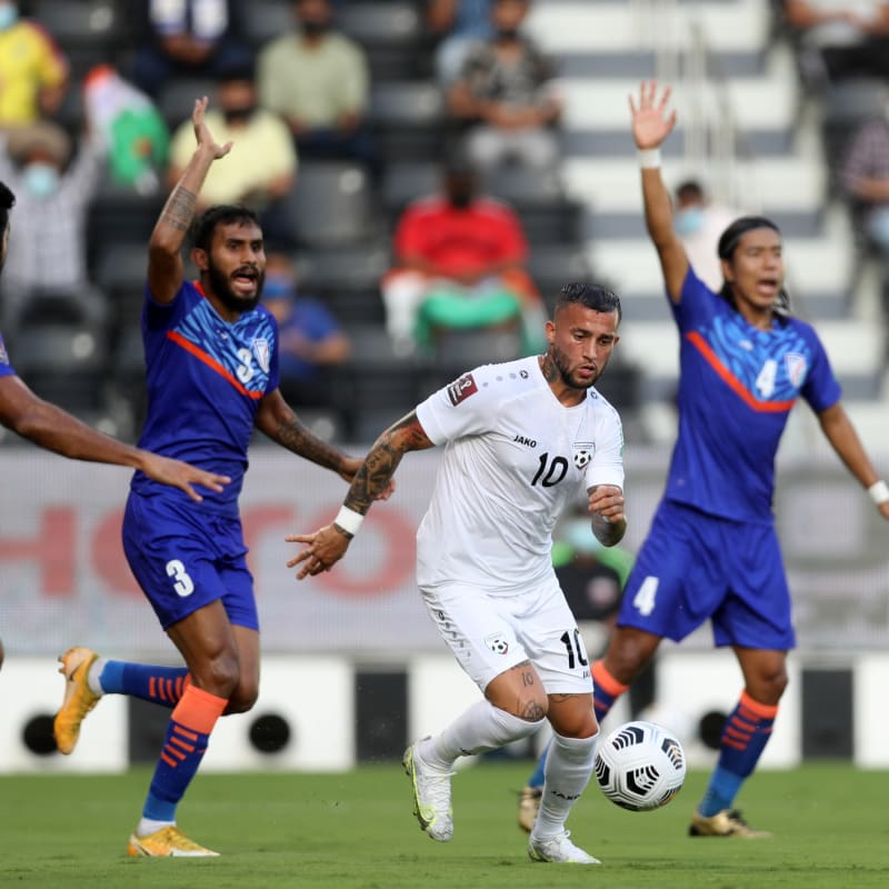 Faysal Shayesteh of Afghanistan dribbles against India