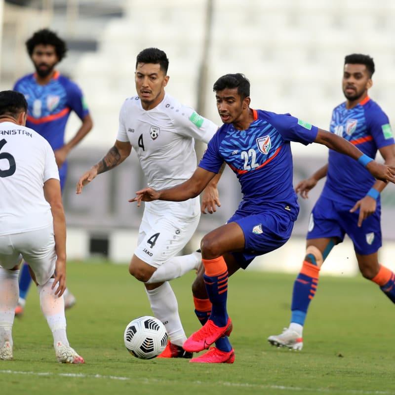 Muhammed Ashique Kuruniyan of India dribbles against Haroon Amiri of Afghanistan in FIFA World Cup Qatar 2022 qualifying