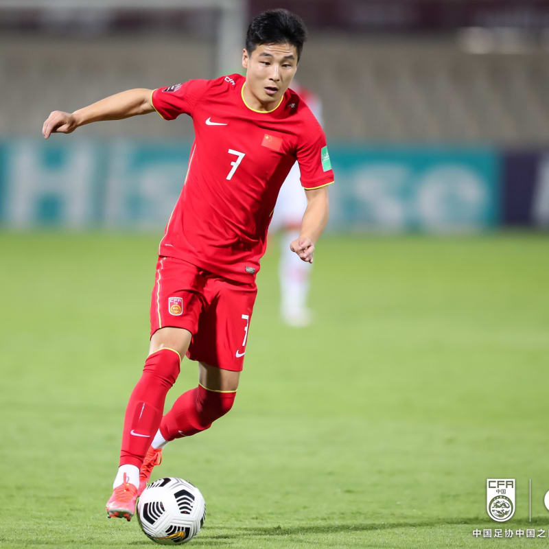Wu Lei of China PR dribbles against Syria