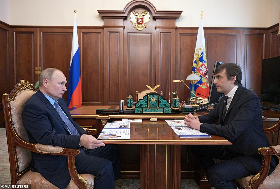 Vladimir Putin is briefed by an adviser in Moscow on Tuesday before he set off for Geneva for his showdown with Biden